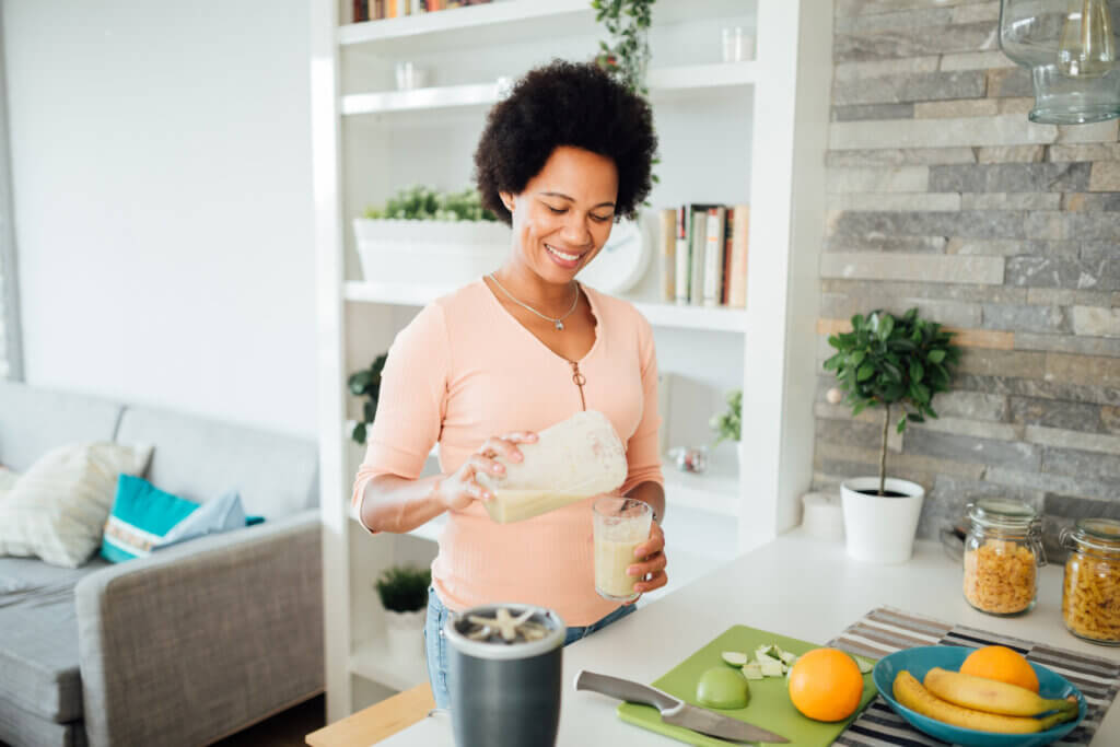 african-american woman making a healthy smoothie